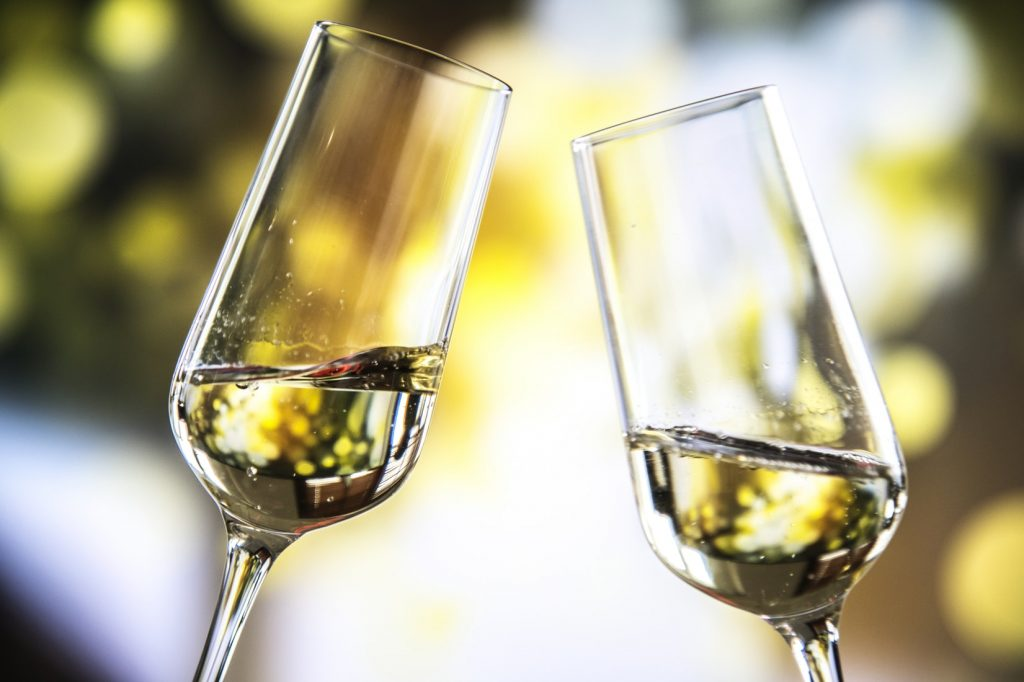 two flute wine glasses toasting by @rawpixel UnSplash 1548138995 c64736224fc2